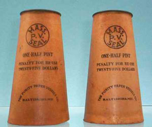 Photo of Purity Paper Milk Cartons, tan waxed cones with paper disk tops.